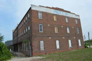 Linn County is accepting development proposals for the Mott Building, along the Cedar River. The building is on the National Register of Historic Places. (photo/Cindy Hadish)