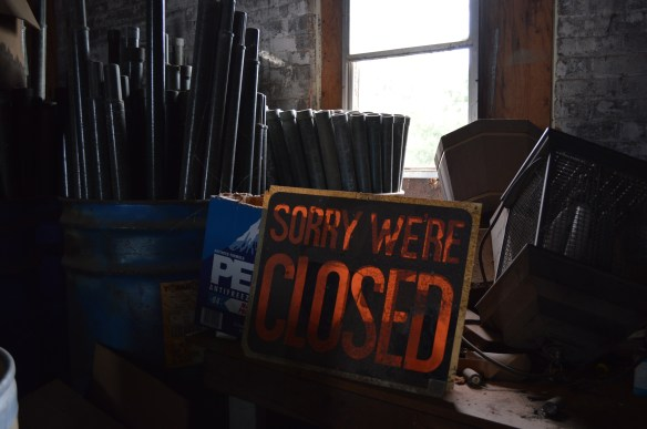 Remnants of previous owners remain strewn throughout the Knutson Building, which the city has put up for redevelopment proposals. (photo/Cindy Hadish)
