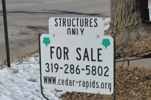 A sign notes that only the structure will be sold, while Cedar Rapids clears an entire city block with no clear purpose in mind. (photo/Cindy Hadish)