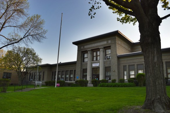 Garfield Elementary in Cedar Rapids, which opened one century ago, featured unique Egyptian-style architecture in a park-like setting when it was built. (photo/Cindy Hadish)