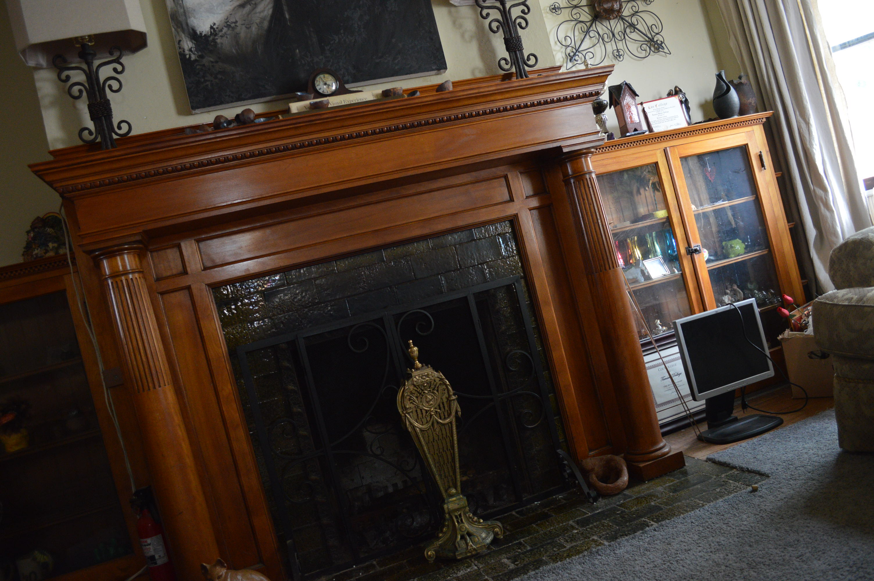 An original fireplace is among the features that Tamara Dallege appreciates about the home in southeast Cedar Rapids. (photo/Cindy Hadish)