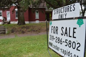 """A """"for sale"""" sign was posted for the brick house, noting that the sale is for the structure only. (photo/Cindy Hadish)"""
