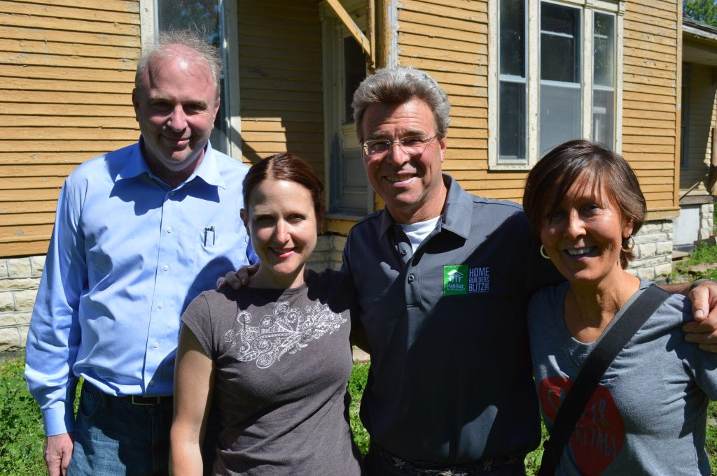 Steve Thomas (second from right) is shown with (left to right) Jeffrey O'Brien, Beth DeBoom and Cindy Hadish in front of the Frankie House on Tuesday, June 7, 2016, in Cedar Rapids, Iowa.