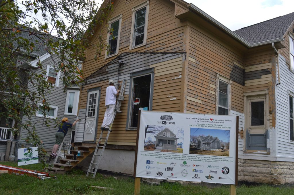 Painting ensued on the exterior of the Frankie House the weekend of Sept. 10-11, 2016. (photo/Cindy Hadish)