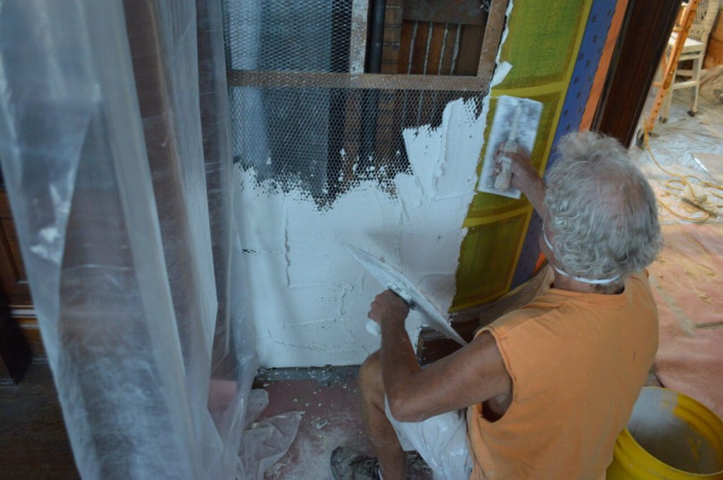 A dying breed: Skilled fourth-generation plasterers repair J.E. Halvorson House in Cedar Rapids