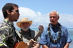 Nick Grube/Honolulu Civil Beat Hawaii Gov. Neil Amercrombie and Honolulu Mayor Kirk Caldwell sing with local musician Makana.