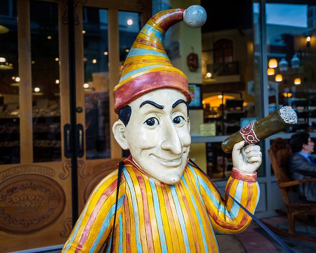 clown smoking cigar
