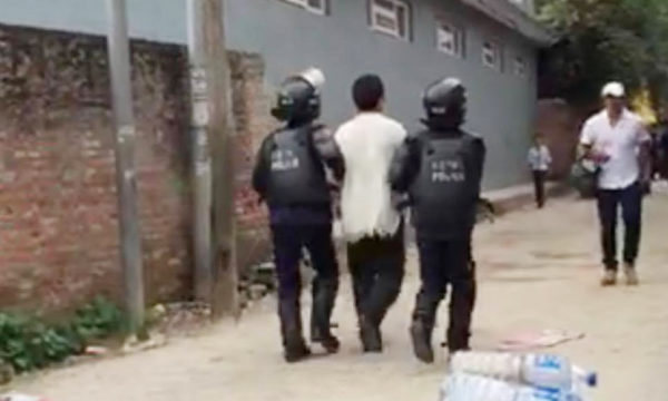 Tibetan being detained by Nepalese police