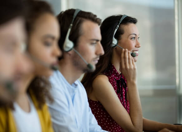 man and woman on telephone headsets