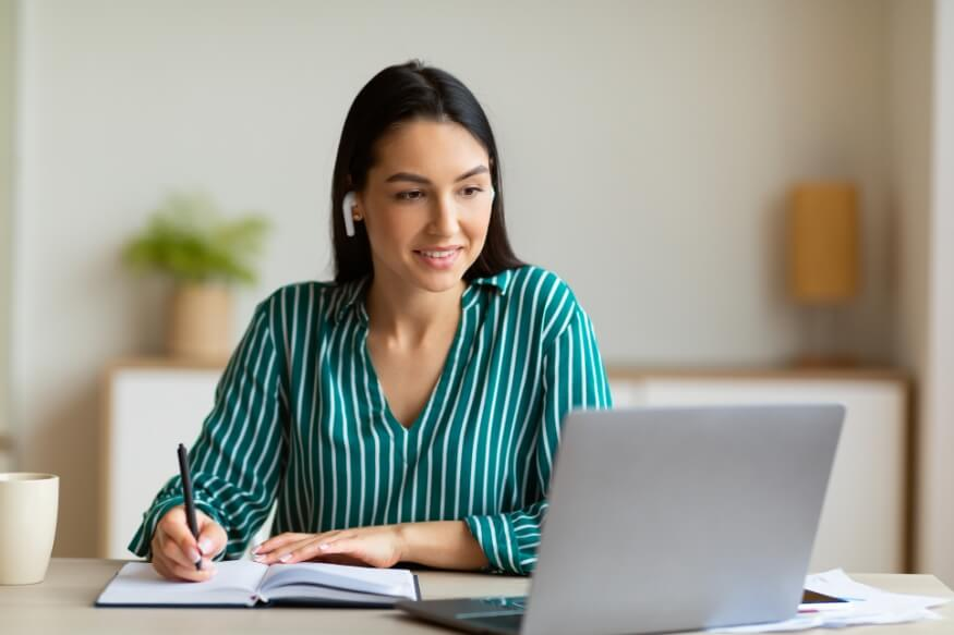 woman at home completing an aptitude test on a laptop