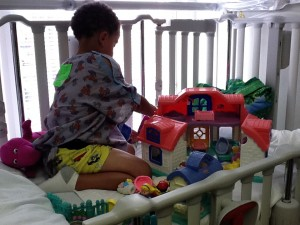 Case playing with his new Little People house