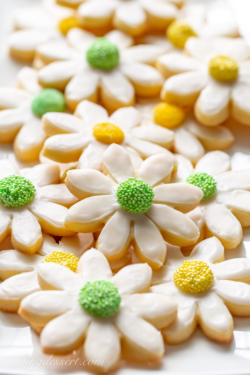 Classic cutout sugar cookies in the shape of flowers