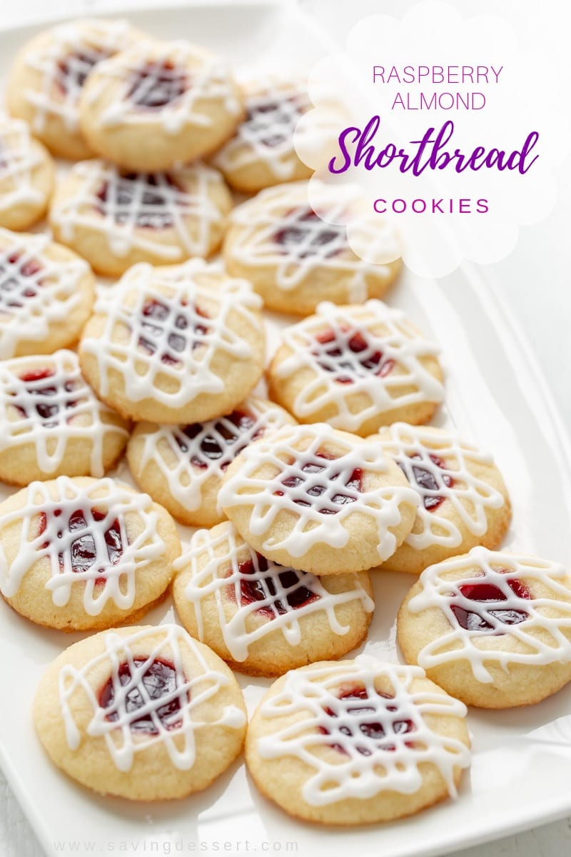 A plate of raspberry almond shortbread cookies drizzled with a simple icing