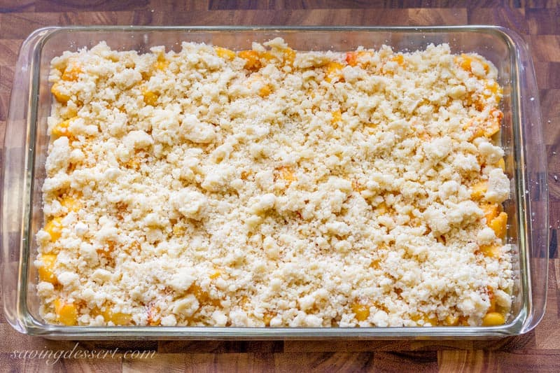 Fresh Peach Crumb Bars with a crumble topping ready to bake