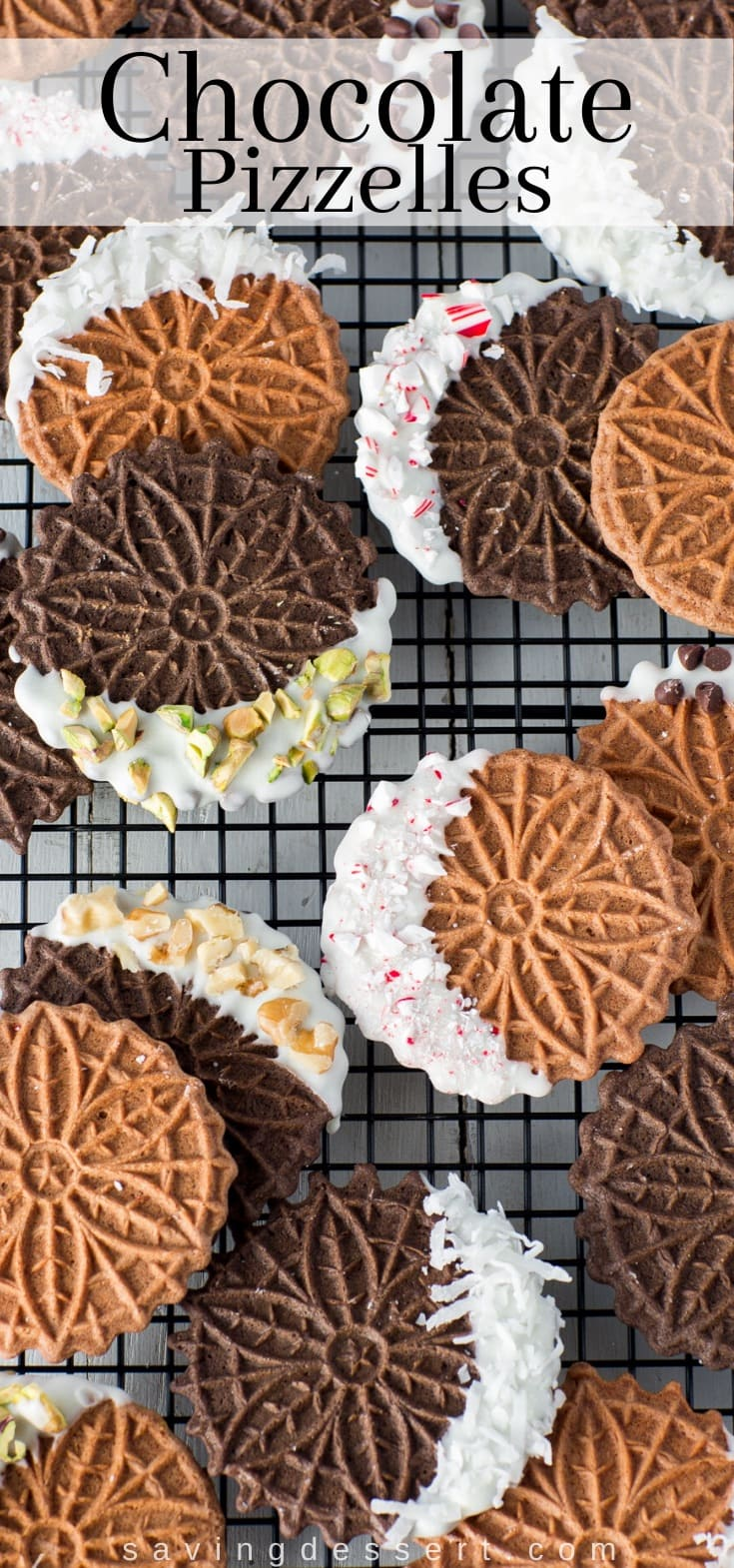 A cooling rack covered in chocolate pizzelle cookies dipped in white chocolate