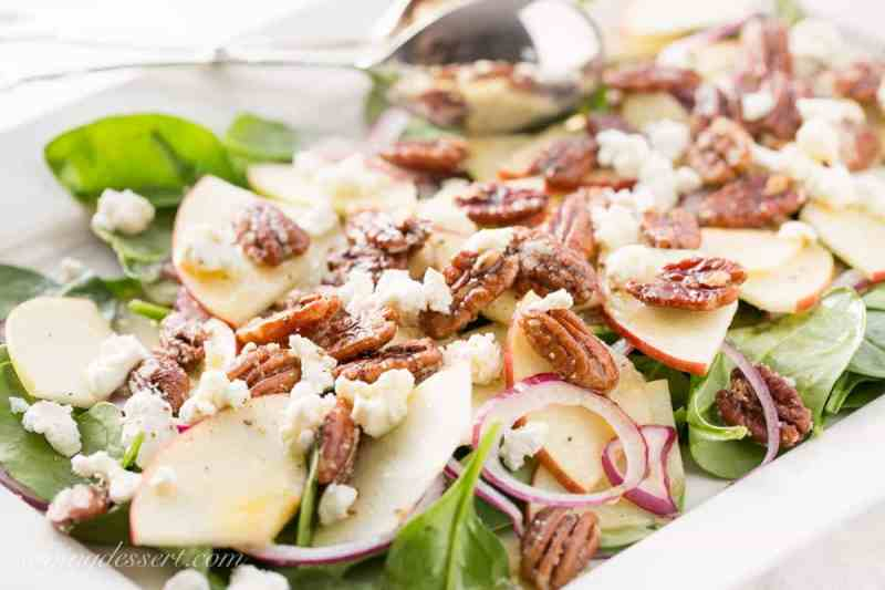 Spinach-Apple Salad with Maple Vinaigrette - Fresh spinach salad with sliced apple, fresh soft goat cheese, red onion slices and sugared pecans and dressed up with a terrific maple-cider vinaigrette with Dijon mustard