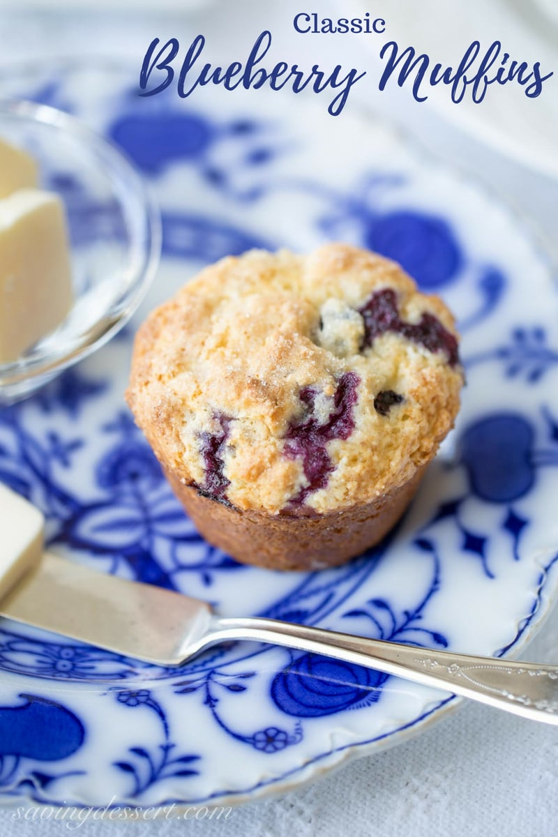 Classic Blueberry Muffins made with fresh juicy blueberries that don't sink to the bottom, a tender, soft crumb that won't fall apart, all tucked under a sugar topped crispy crust. #savingroomfordessert #blueberrymuffins #muffins #bestblueberrymuffins #brunch #breakfast #blueberry