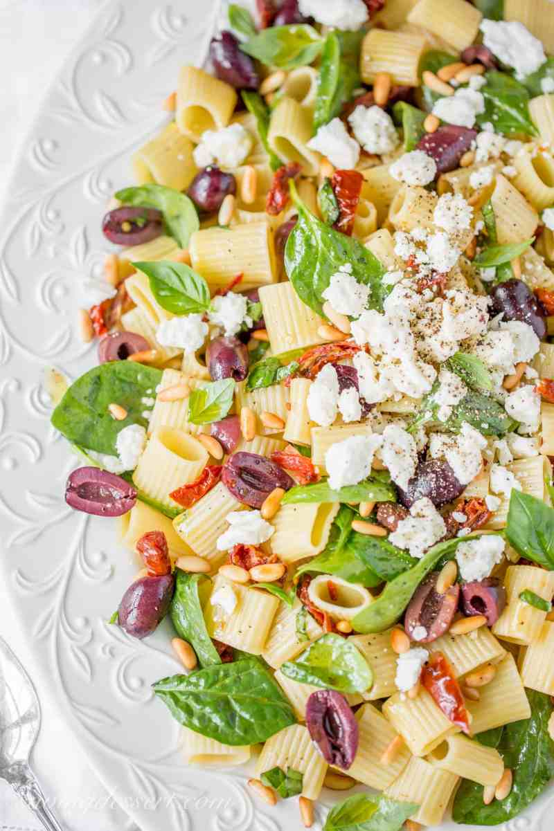 Sun Dried Tomatoes with Mezzi Rigatoni and Feta. Add fresh spinach, basil, olives and pine nuts for an amazing meatless main or hearty side!