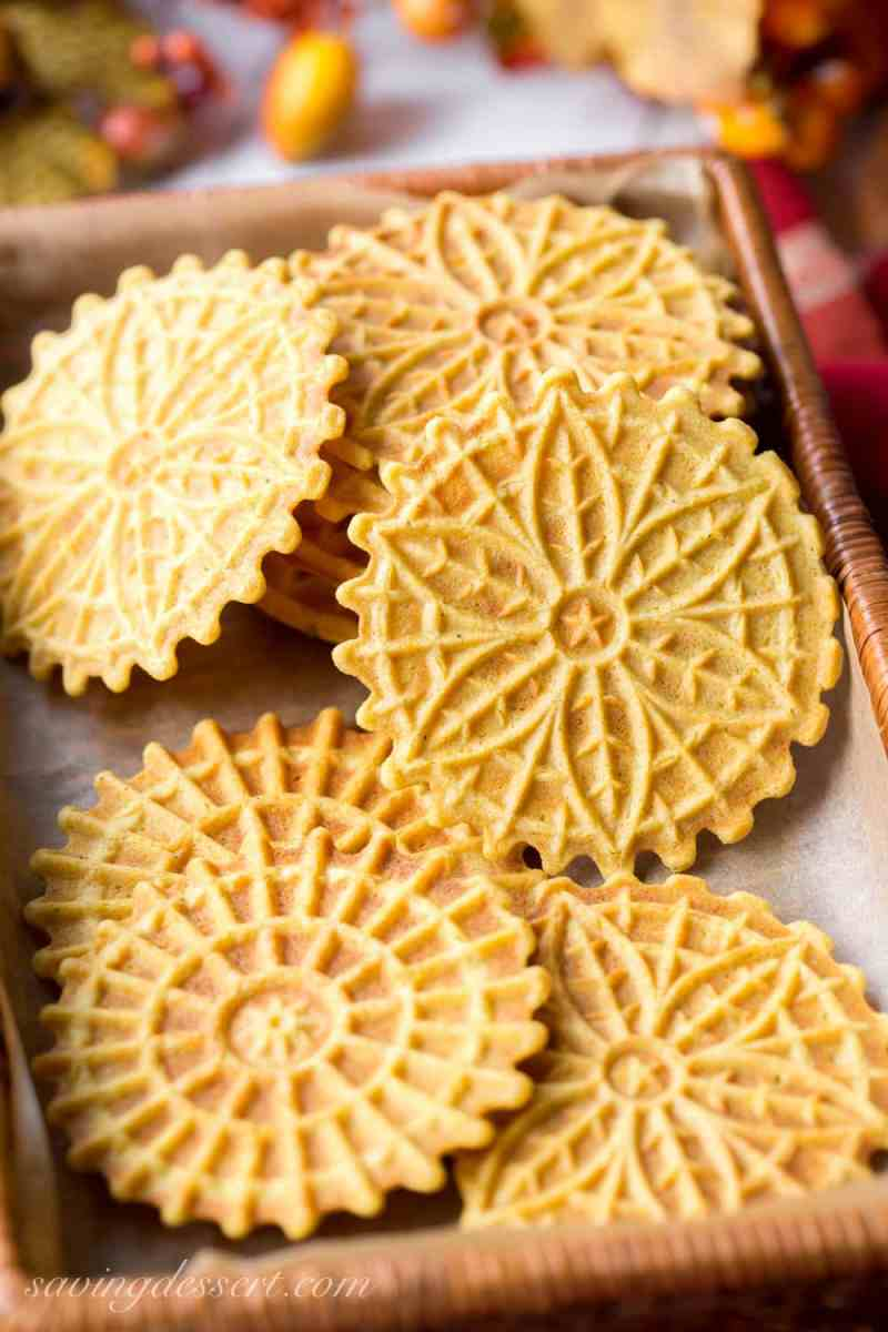 A basket filled with pumpkin flavored pizzelle cookies