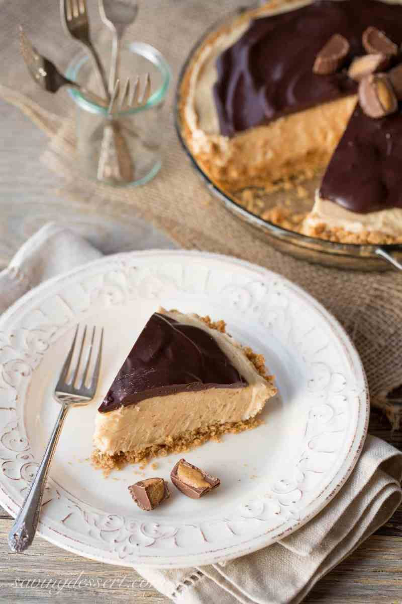 A slice of peanut butter pie with chocolate ganache and served with mini Reeses Cups.