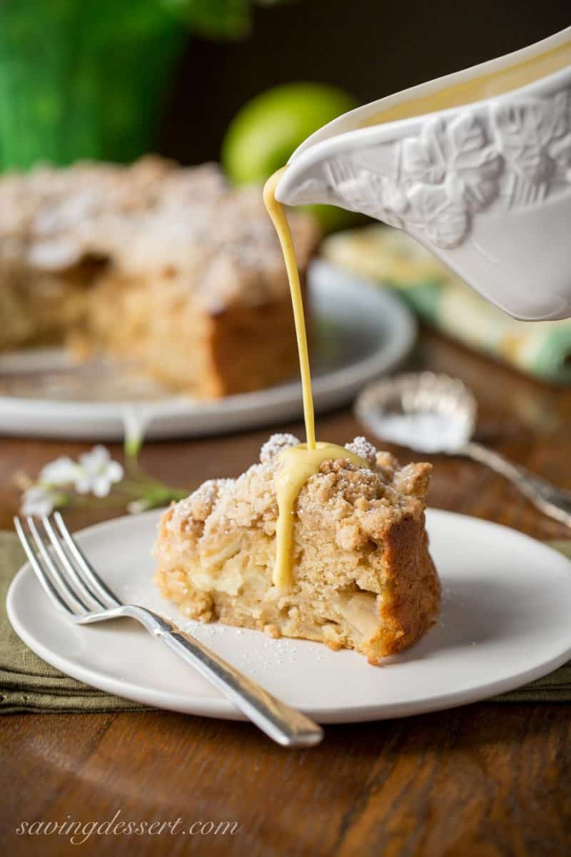 A slice of Irish Apple Cake drizzled with a apple brandy sauce