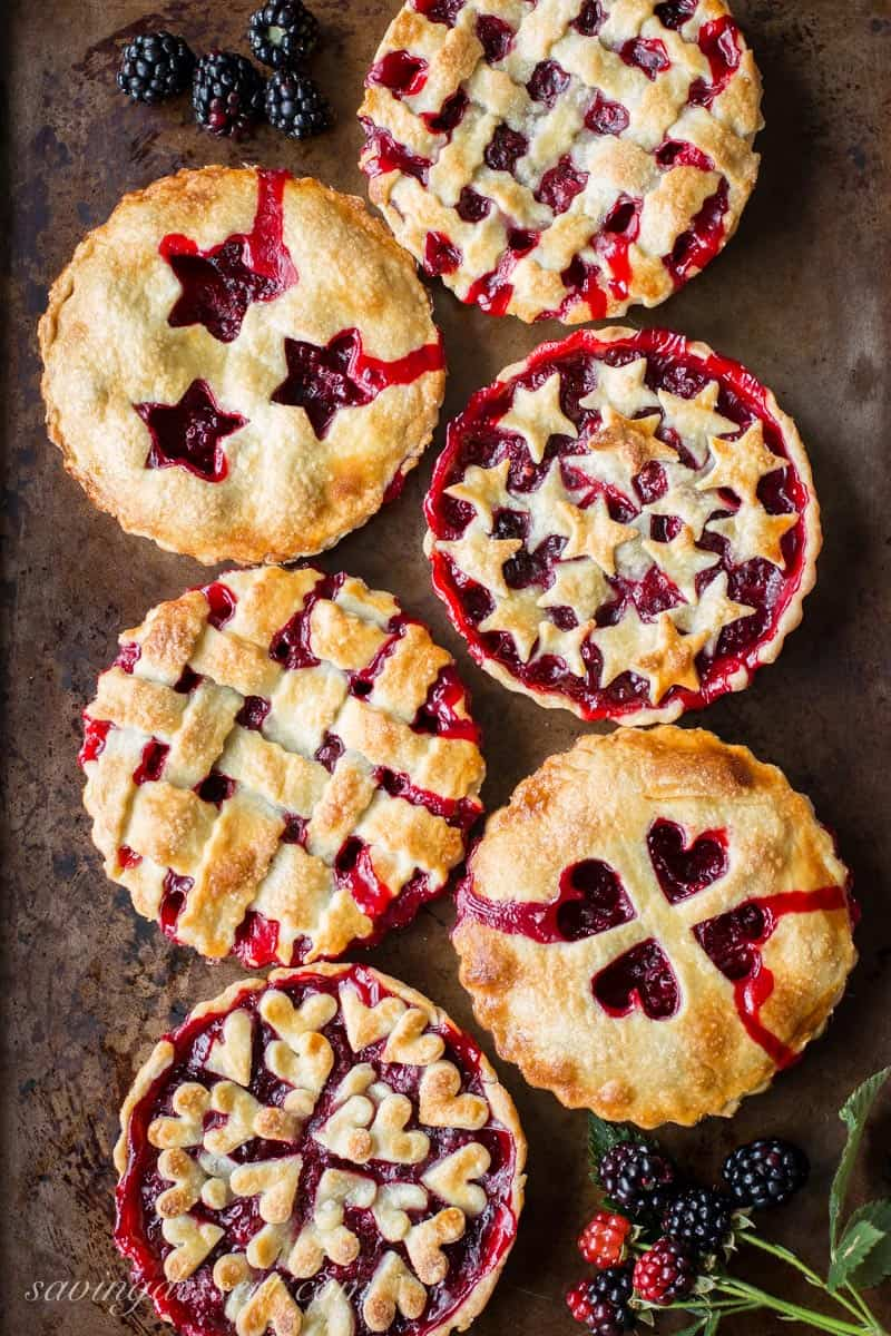 Blackberry Tarts ~ juicy, ripe blackberries nestled in a buttery, flaky crust for an iconic, all American summer dessert #blackberry #summer #pie