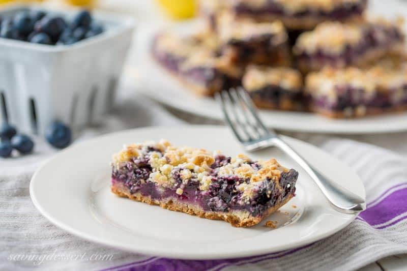 Blueberry Crumb Bars ~there's nothing like sweet summer blueberries baked in a simple crust to excite the taste buds! This simple, easy dessert is saturated with intense blueberry flavor and hints of bright, fresh lemon. www.savingdessert.com