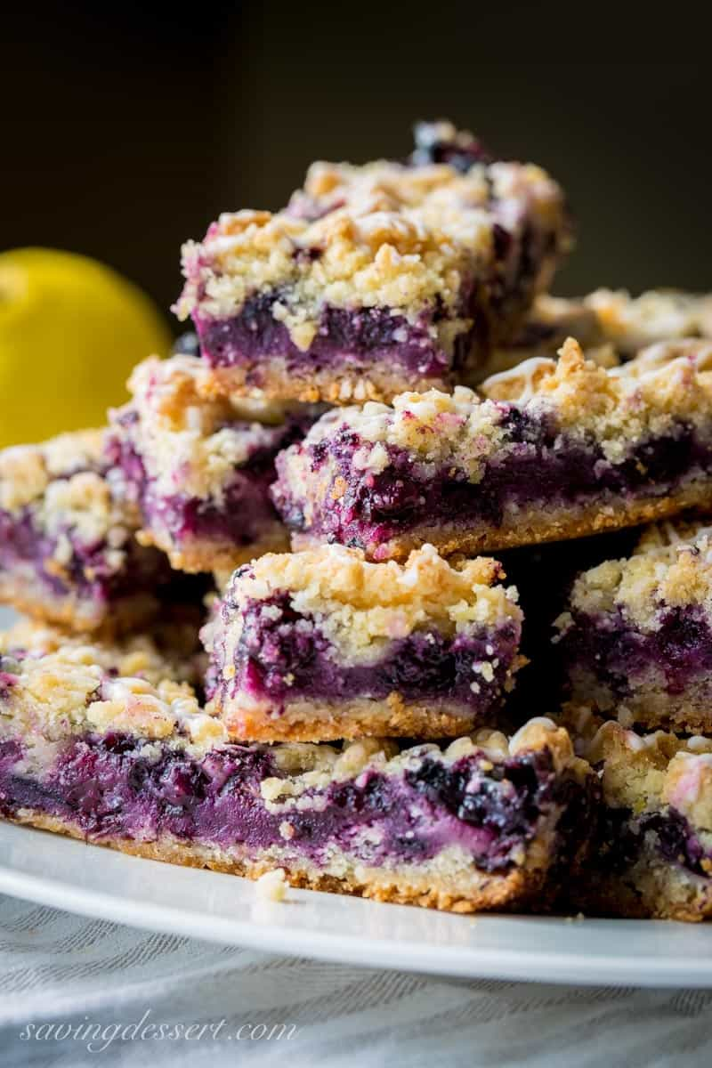 Blueberry crumb bars stacked on a plate