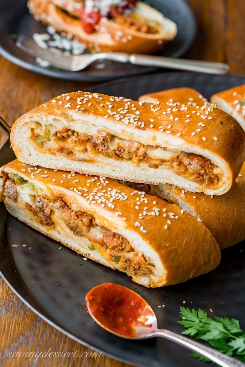 Sliced cheesy meatball stromboli with pizza sauce