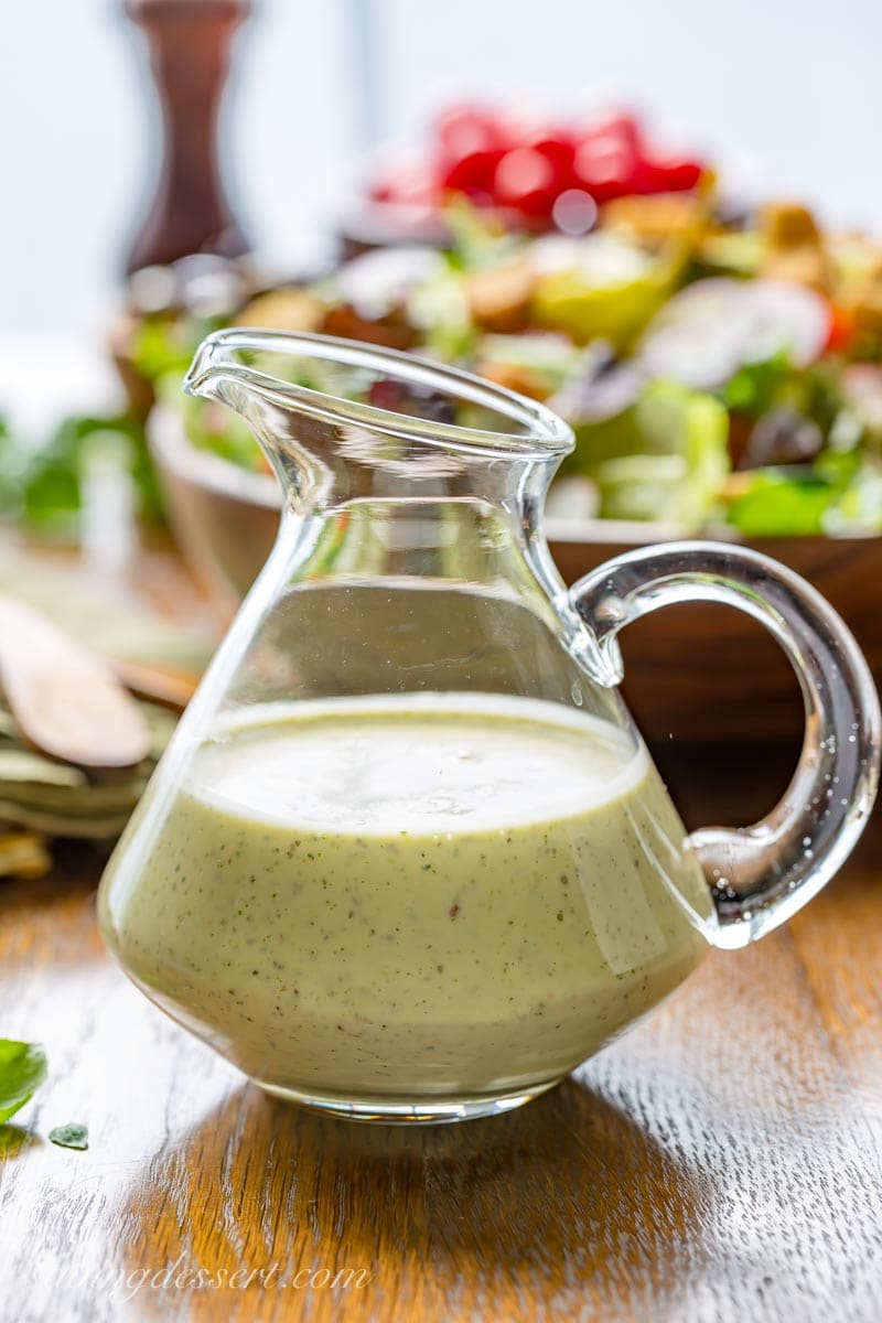 a cruet with homemade Creamy Italian Dressing and a fresh tossed salad