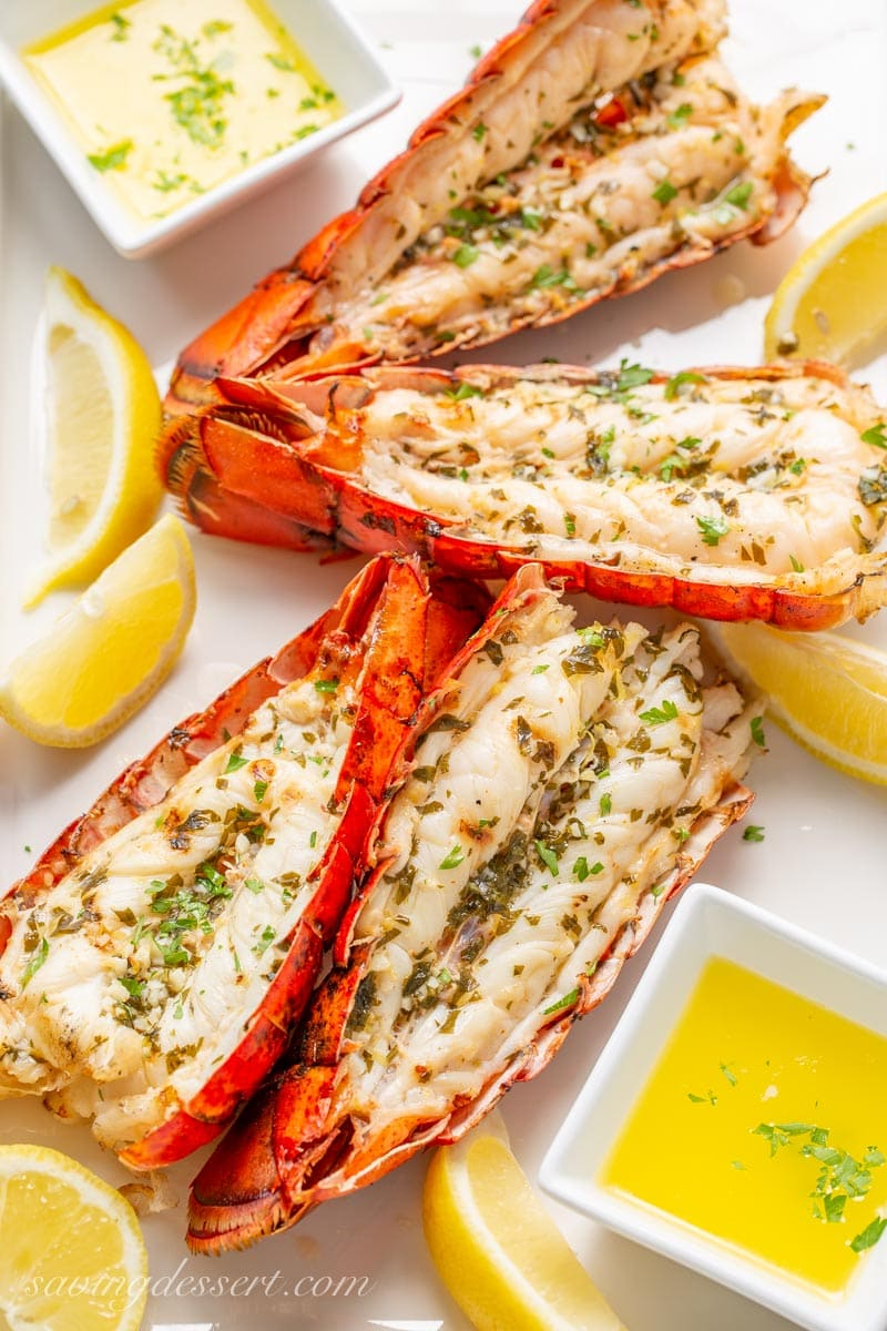 grilled lobster tails with melted butter and lemon wedges
