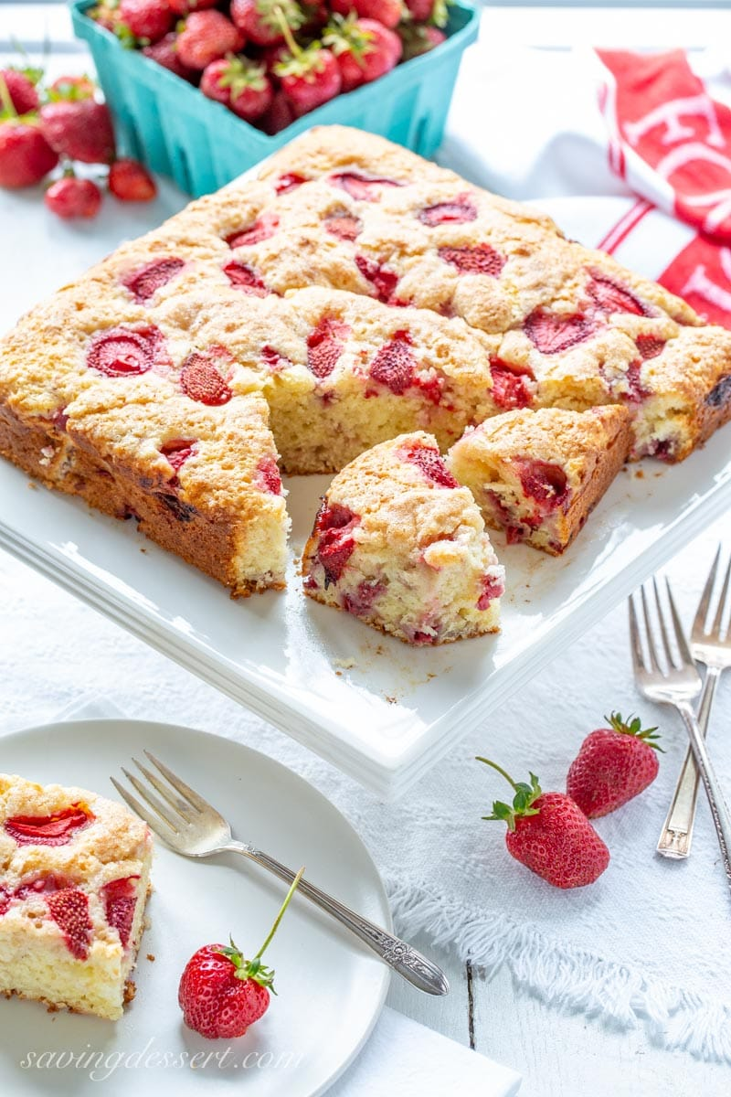 A square Strawberry Breakfast Cake cut into pieces