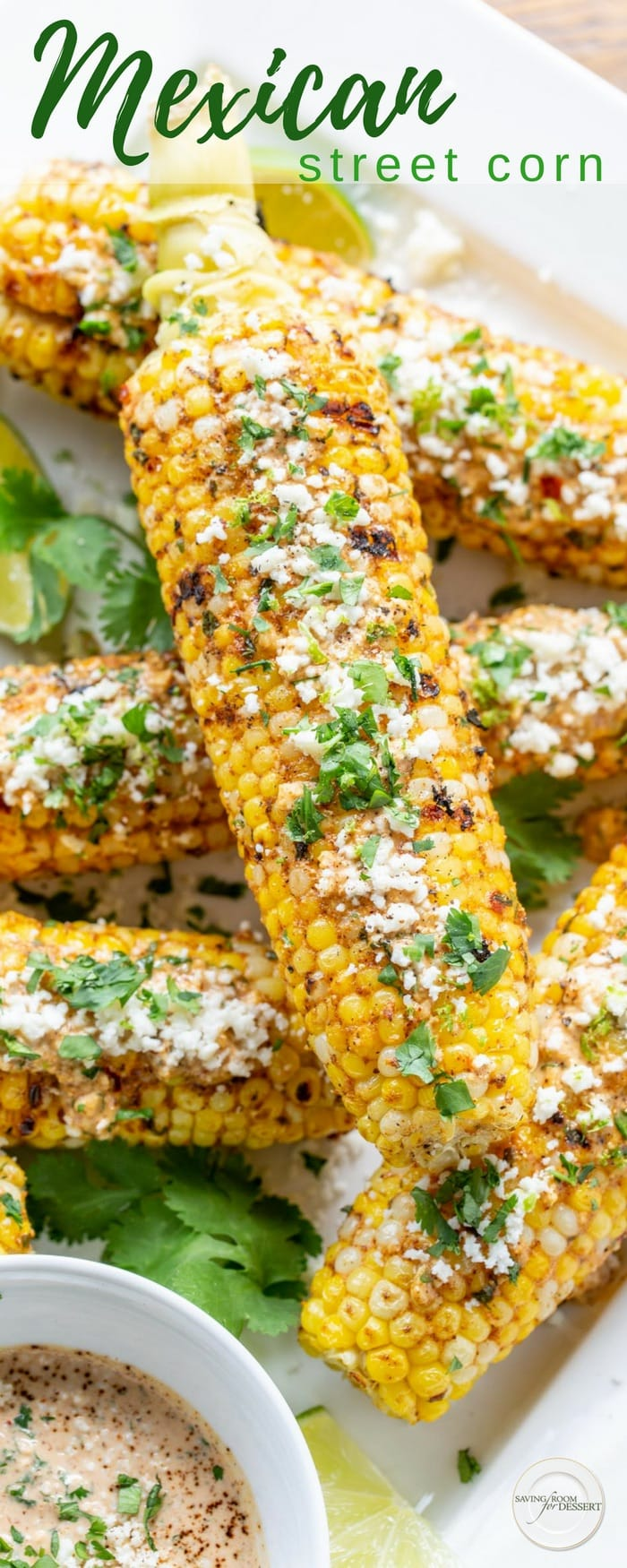 Grilled Mexican Street Corn (Elote) - a wonderfully messy, well spiced, delicious summer treat! Sweet summer corn is slathered in a mixture of mayonnaise, garlic, lime juice, chili powder and Cotija cheese then grilled to perfection. #streetcorn #grilled #grilledcorn #corn #mexicanstreetcorn #mexican #summercorn #vegetable #grilledvegetable