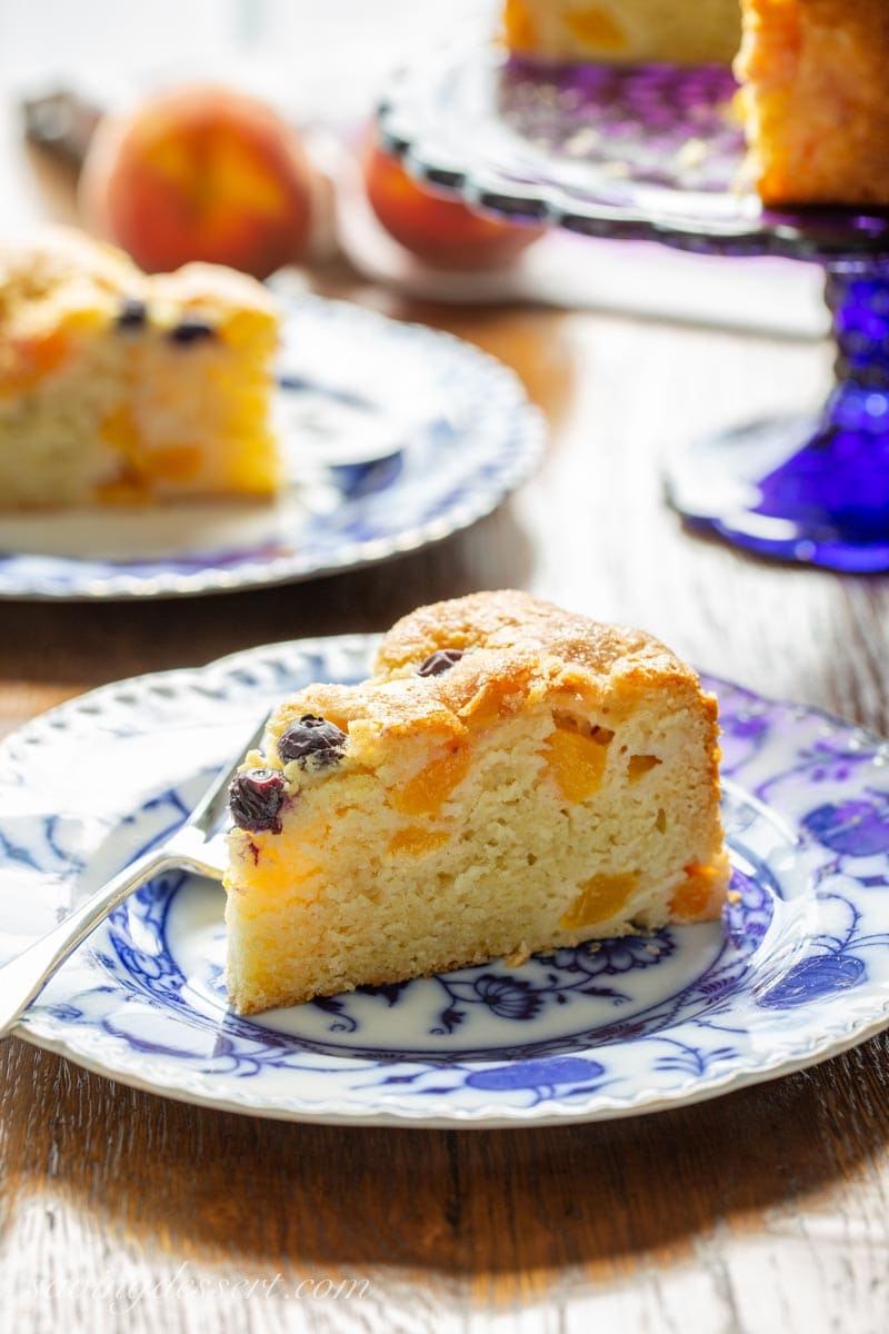 A slice of peach and blueberry breakfast cake