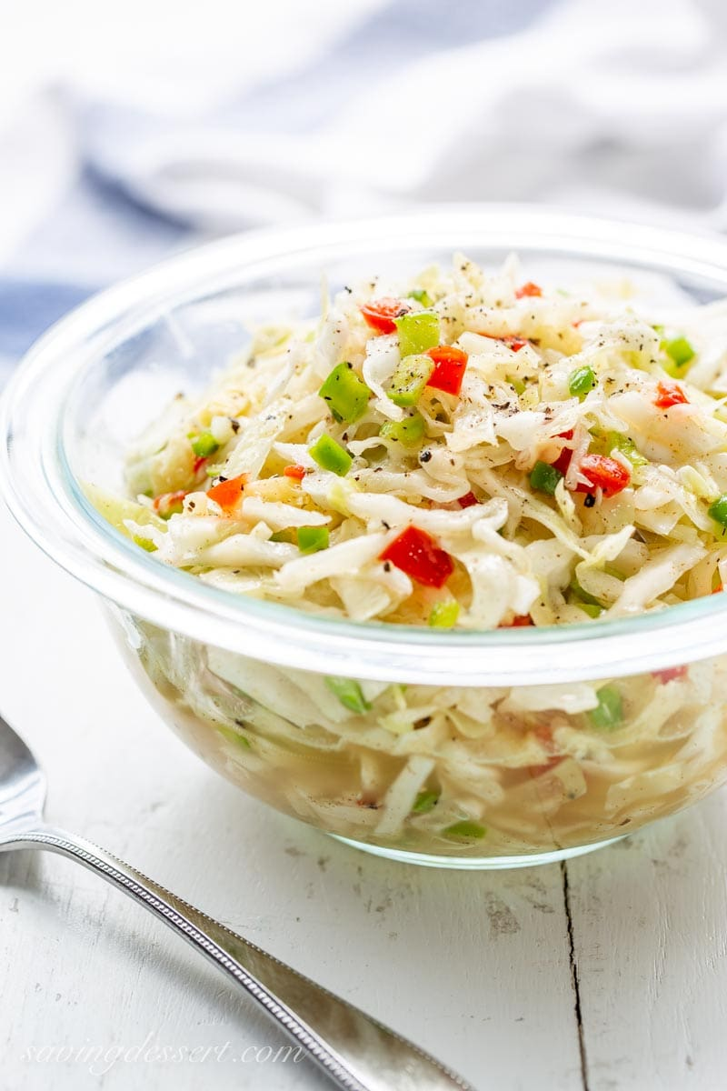 A mayo-free simple cabbage slaw with pimentos, onion and chopped green pepper.