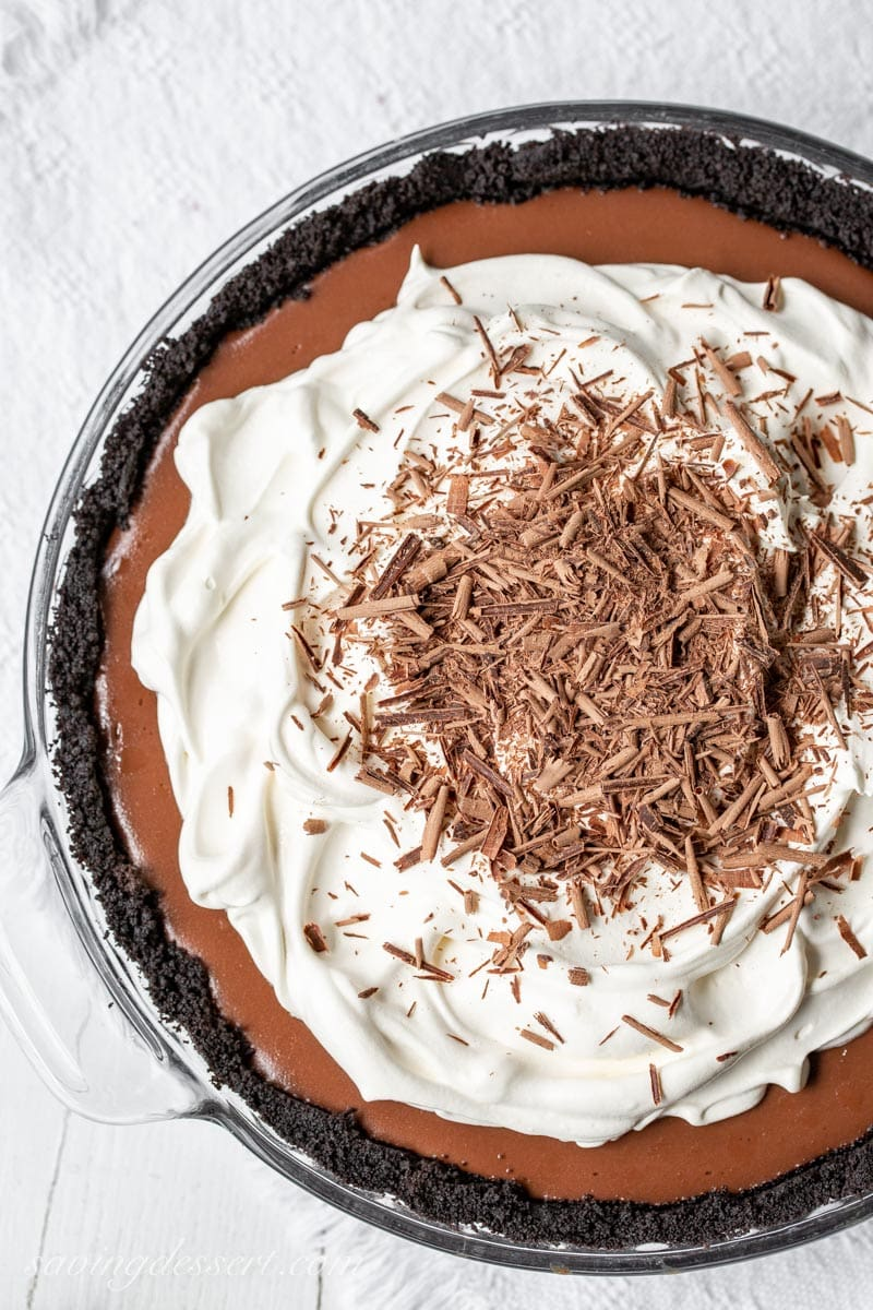 Double Chocolate Cream Pie with a chocolate cookie crumb crust, whipped cream and chocolate shavings on top