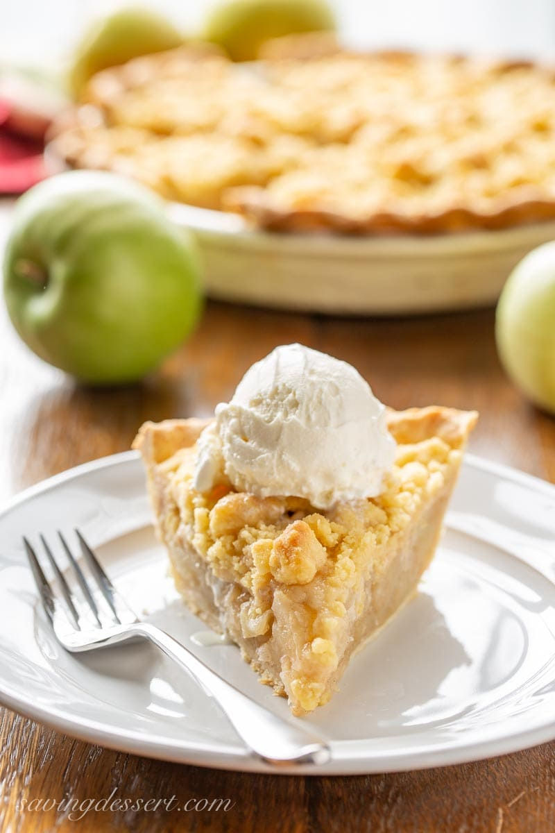 Dutch apple pie topped with a scoop of vanilla ice cream