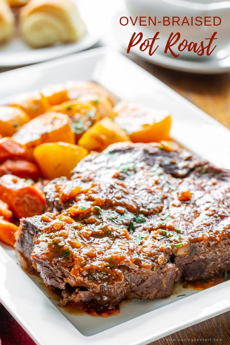 A platter of oven-braised pot roast with carrots and potatoes