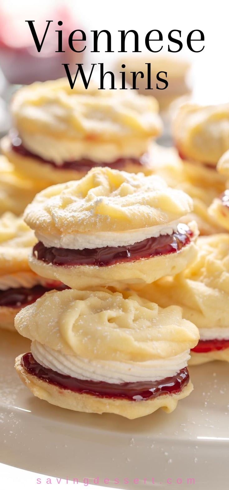 A stack of Viennese Whirls - butter cookies filled with jam and buttercream frosting