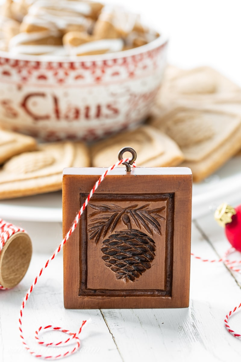 A Springerle mold with a pine cone design to make Speculaas cookies