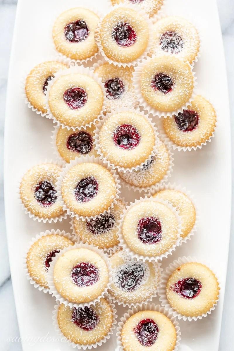 A plate of blueberry jam almond tea cakes