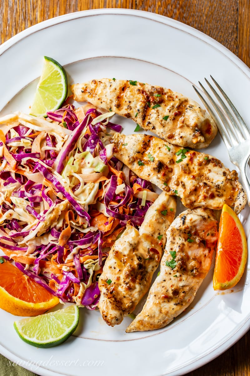 A plate with spicy purple slaw and grilled chicken tenders