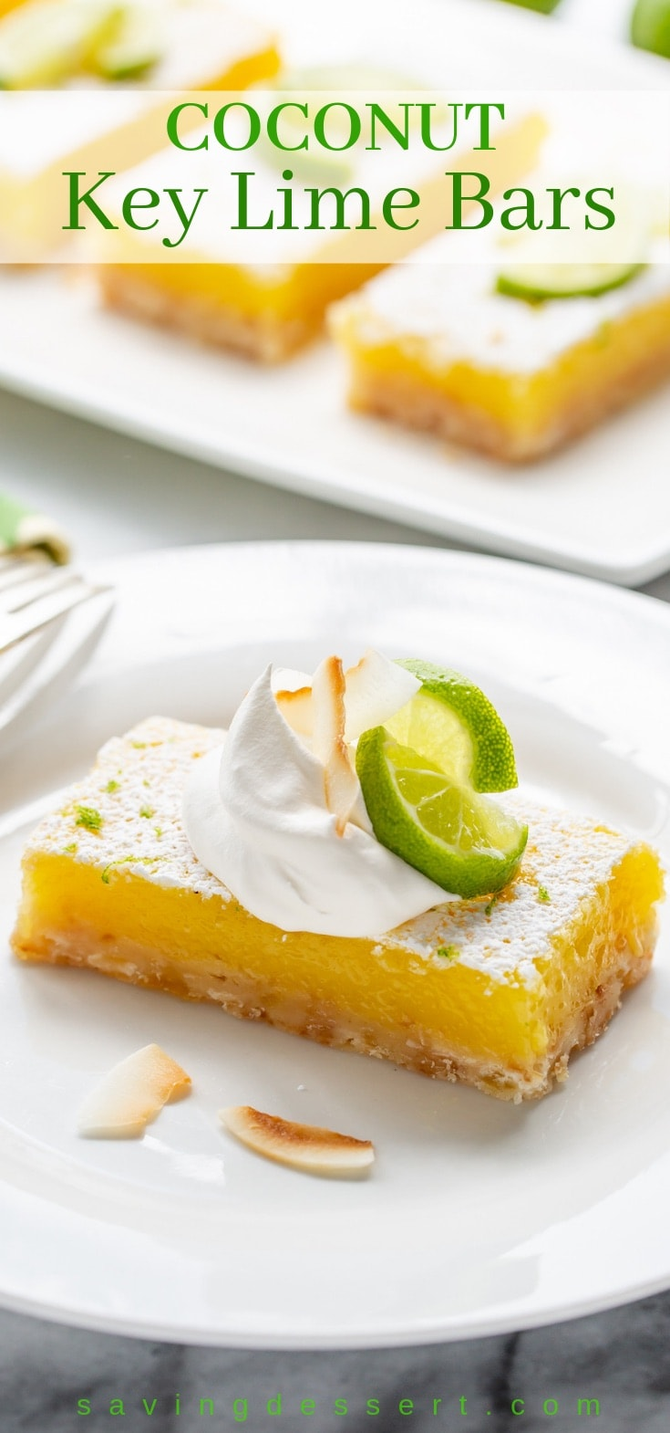 Coconut Key Lime Bars topped with lime wedges, toasted coconut and a dollop whipped cream
