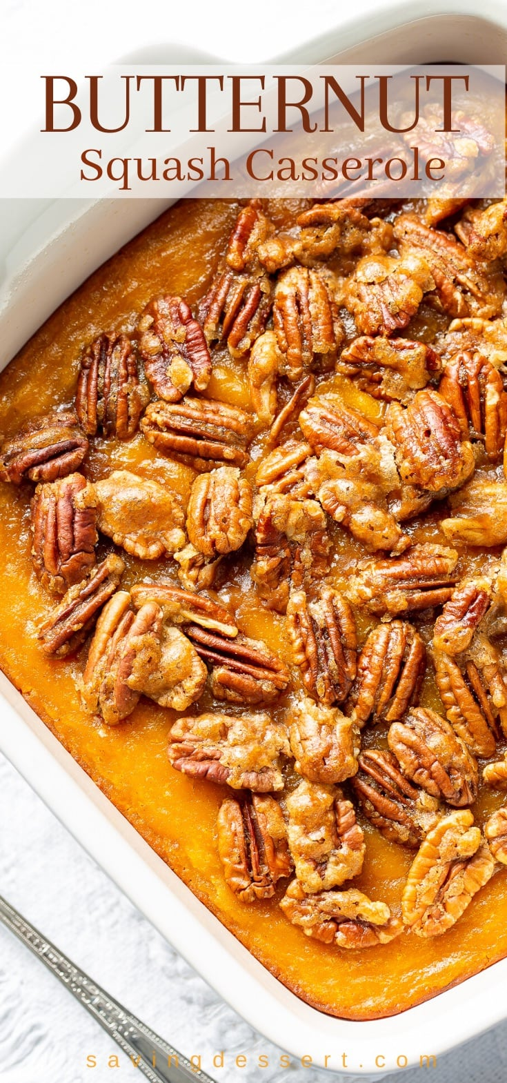Butternut squash casserole topped with pecans