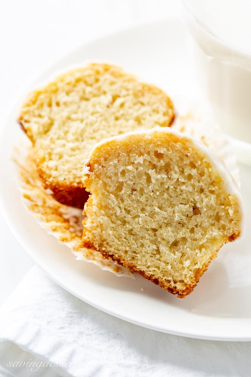 A vanilla muffin sliced in half on a plate