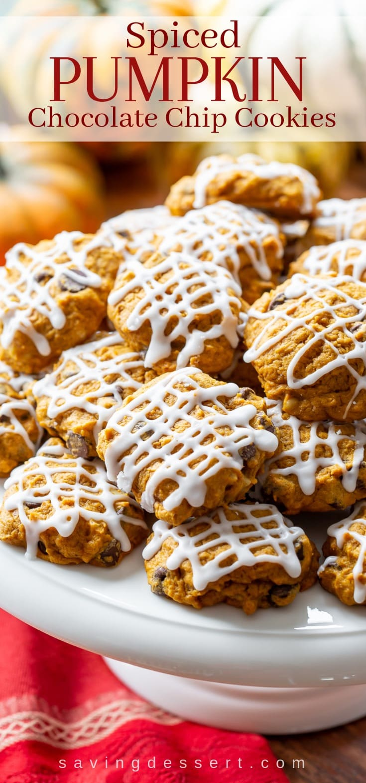 A stack of iced pumpkin chocolate chip cookies