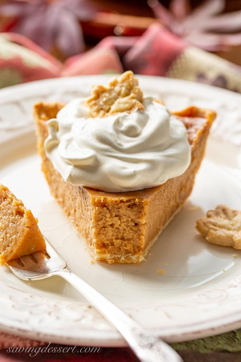 A slice of apple butter pie topped with whipped cream