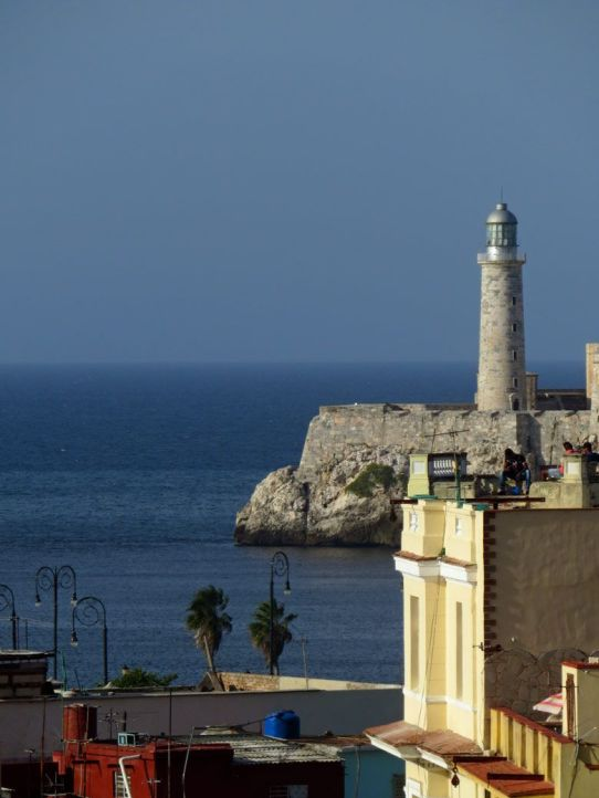 The views from Old Havana stretch out to the Malecon and lighthouse. Visit Havana today before the travel ban is lifted and modernization begins to take place.
