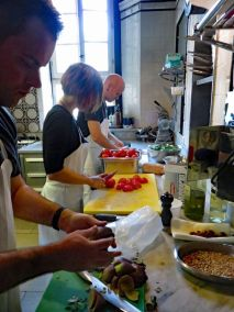Chopping ingredients for our tomato sauce and cleaning the artichokes