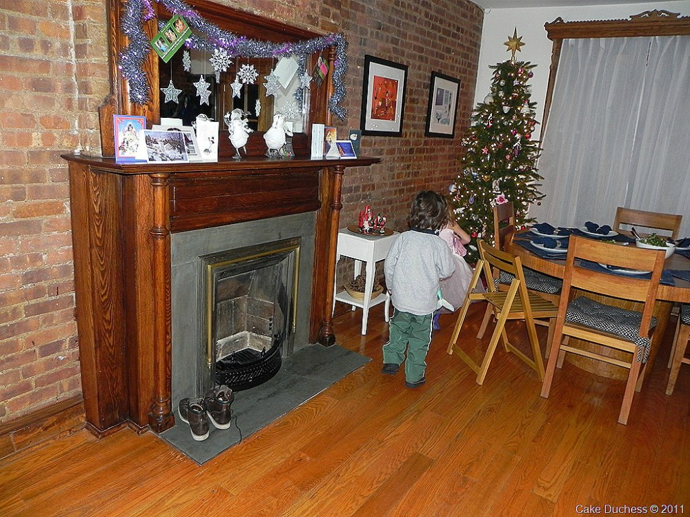 image of fireplace and christmas tree in an apartment